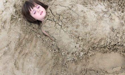 Children eating sand