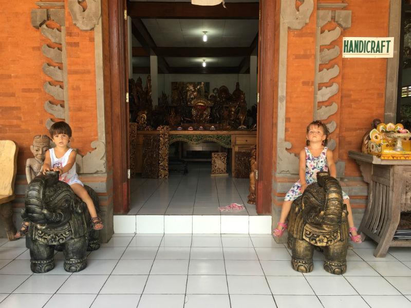 Riding metal elephants sculptures in Bali